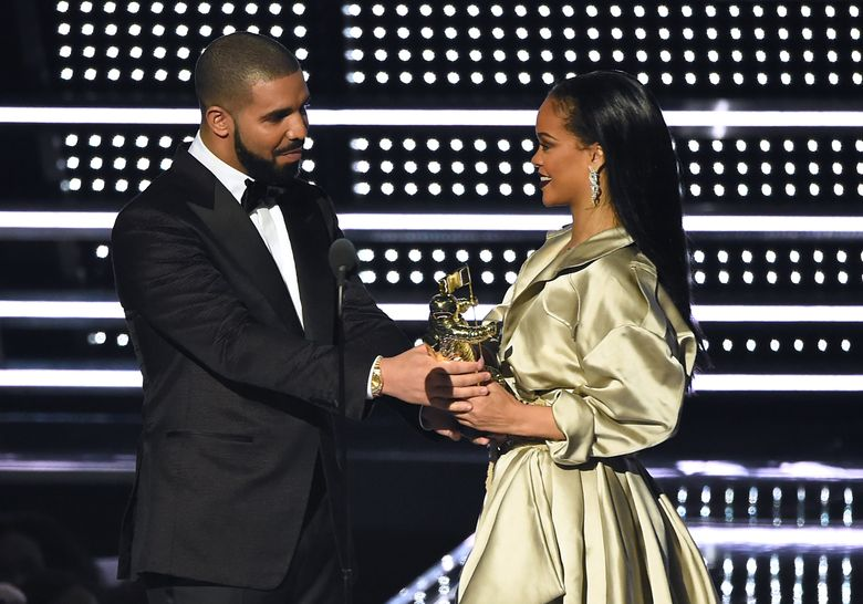 """FILE – In this Aug. 28, 2016, file photo, Drake, left, presents the Michael Jackson Video Vanguard Award to Rihanna at the MTV Video Music Awards at Madison Square Garden in New York. Rihanna thanked Drake on Instagram Friday, Sept. 2, 2016, for his presentation, calling the rapper's speech """"touching."""" (Photo by Charles Sykes/Invision/AP, File)"""