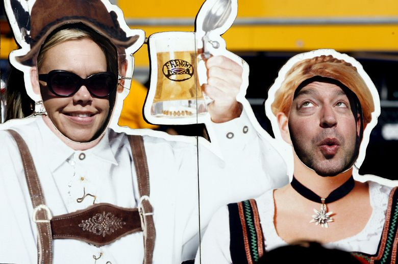 Cutouts at Fremont's Oktoberfest allowed people to be playful.  (Alan Berner / The Seattle Times)