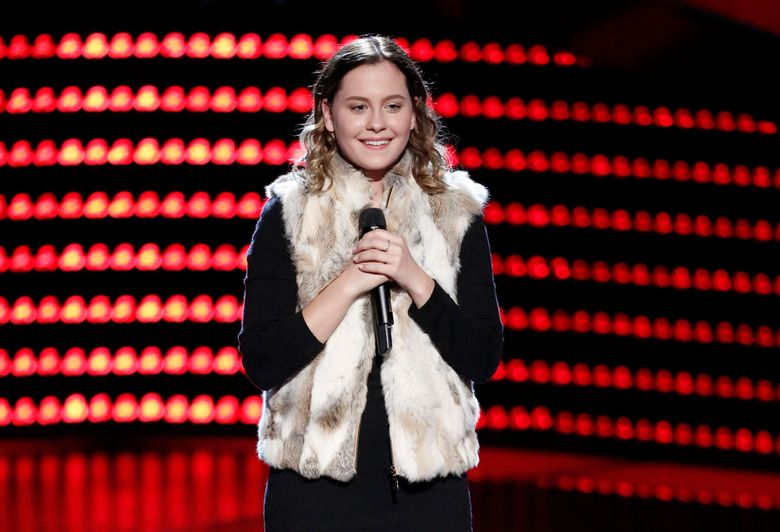 """In this image released by NBC, Natasha Bure appears on the singing competition series, """"The Voice,"""" in an episode airing Monday, Oct. 3, 2016. Bure is the 18-year-old daughter of """"Fuller House"""" star Candace Cameron Bure and was selected by judge Adam Levine during her rendition of Elvis Presley's """"Can't Help Falling in Love"""" on Monday's show. (Tyler Golden/NBC via AP)"""