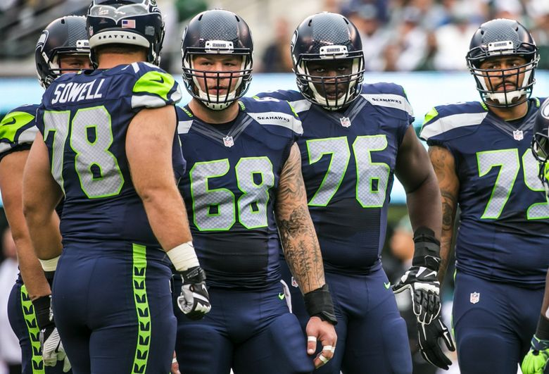 Offensive linemen from left, Bradley Sowell, Justin Britt, Germain Ifedi and Garry Gilliam line up in the huddle in the first quarter during the game against the New York Jets on Sunday.  (Bettina Hansen / The Seattle Times)