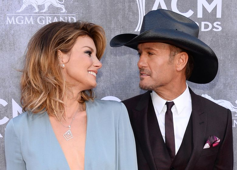 Faith Hill, left, and Tim McGraw arrive at the 49th annual Academy of Country Music Awards at the MGM Grand Garden Arena on Sunday, April 6, 2014, in Las Vegas. (Al Powers/Powers Imagery/Invision/AP)