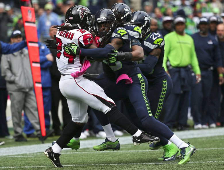 Seahawks defenders swarm Falcons Devonta Freeman in the second quarter on third down. (Bettina Hansen / The Seattle Times)