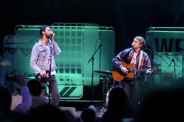 The Head and Heart, pictured here at KeyArena, will perform at the Deck the Hall Ball at KeyArena Dec. 6. (John Lok / The Seattle Times)