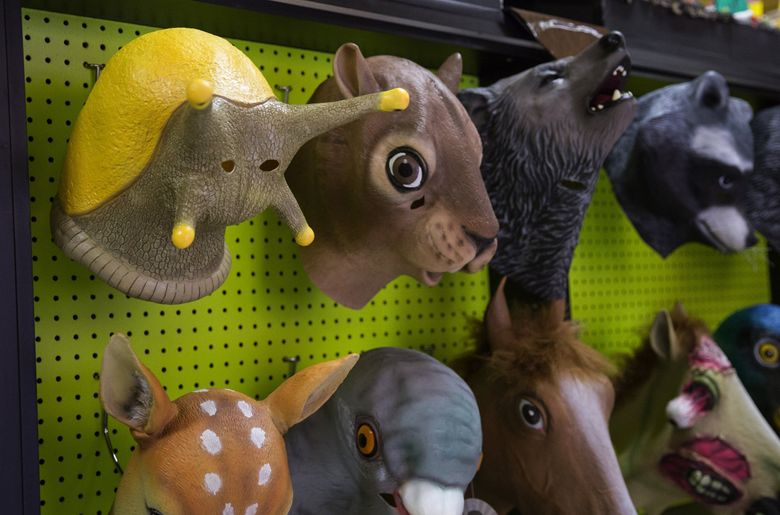 """Archie McPhee's newest hot-selling product, a banana slug mask, has posable feelers, """"fits most adult heads,"""" and is """"great for irritating gardeners."""" Thanks to social media posts announcing the mask, """"we had people coming in and asking about it an hour before it even came in,"""" said employee Chris Hope. Photographed on Sunday, Oct. 16, 2016. (Lindsey Wasson / The Seattle Times)"""