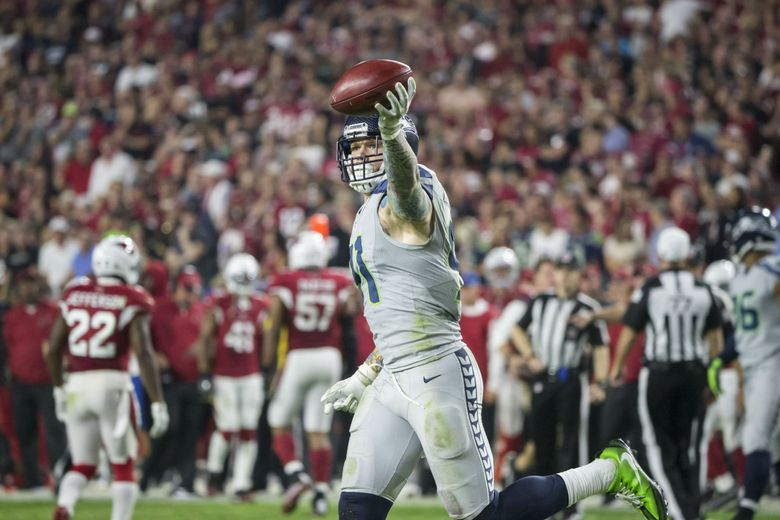 Seattle Seahawks defensive end Cassius Marsh (91) celebrates after recovering a blocked punt during the fourth quarter as the Seattle Seahawks take on the Arizona Cardinals at University of Phoenix Stadium in Glendale, Arizona Sunday October 23, 2016. (Bettina Hansen / The Seattle Times)