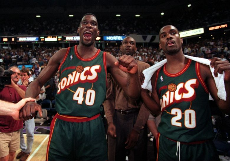 Sonics Shawn Kemp and Gary Payton celebrate the win over the Kings. (5/8/1996) (Rod Mar / THE SEATTLE TIMES)