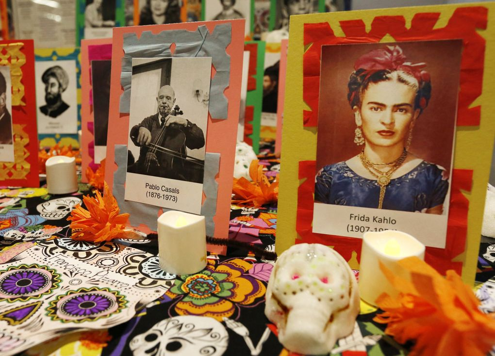Mexican artist Frida Kahlo and Spanish musician Pablo Casals are among those honored by this display at a Día de Muertos celebration at Seattle Center Armory in 2014. (Alan Berner / The Seattle Times)