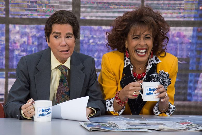 """Kathie Lee Gifford, left, dressed as her former co-host Regis Philbin, and Hoda Kotb, dressed as Kathie Lee Gifford from the morning talk show, """"Live! With Regis and Kathie Lee,"""" appear during NBC's """"Today"""" show Halloween celebration at Rockefeller Plaza on Monday, Oct. 31, 2016, in New York. (Photo by Charles Sykes/Invision/AP) NYCS106  (Charles Sykes / Charles Sykes/Invision/AP)"""
