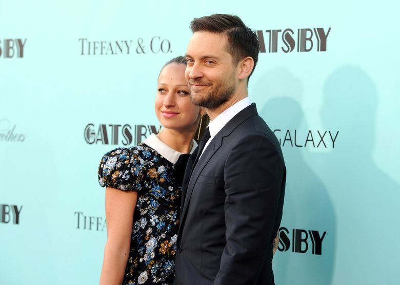 """FILE – In this May 1, 2013, file photo, actor Tobey Maguire, right, and wife Jennifer Meyer attend """"The Great Gatsby"""" world premiere in New York. A representative for Maguire confirmed a People magazine report on Oct. 18, 2016, that Maguire and Meyer have separated after nine years of marriage. (Photo by Evan Agostini/Invision/AP, File)"""