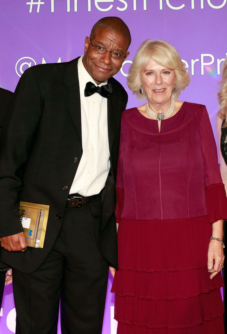 """Winner of the 2016 Man Booker Prize for the novel, """"The Sellout"""", Paul Beatty, left, poses for photographers with Camilla, the Duchess of Cornwall, during the 2016 Man Booker Prize ceremony, at The Guildhall, in London, Tuesday, Oct. 25, 2016. Beatty's """"The Sellout,"""" a stinging satire of race and class in the United States, won the Man Booker Prize on Tuesday –the first time an American has taken the prestigious fiction award.  (John Phillips/AP)"""