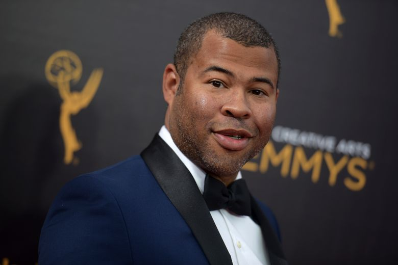 """FILE – In this Sept. 11, 2016, file photo, Jordan Peele arrives at night two of the Creative Arts Emmy Awards in Los Angeles. The trailer for Peele's upcoming film, """"Get Out,"""" debuted online on Oct. 4, 2016. (Photo by Richard Shotwell/Invision/AP, File)"""