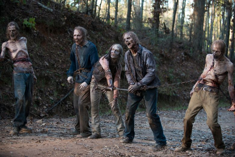"""Zombies — walkers in the show's parlance — are the least of the worries of the humans left alive in AMC's hit """"The Walking Dead."""" (Gene Page/AMC)"""