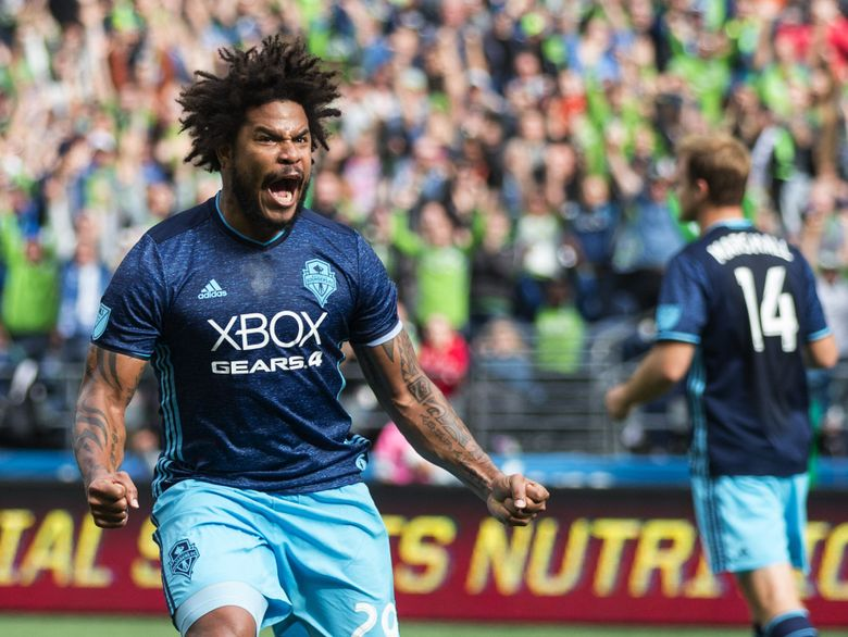 Sounders defender Roman Torres reacts as he sees Seattle Sounders midfielder Cristian Roldan's goal land in the net. (Lindsey Wasson/The Seattle Times)