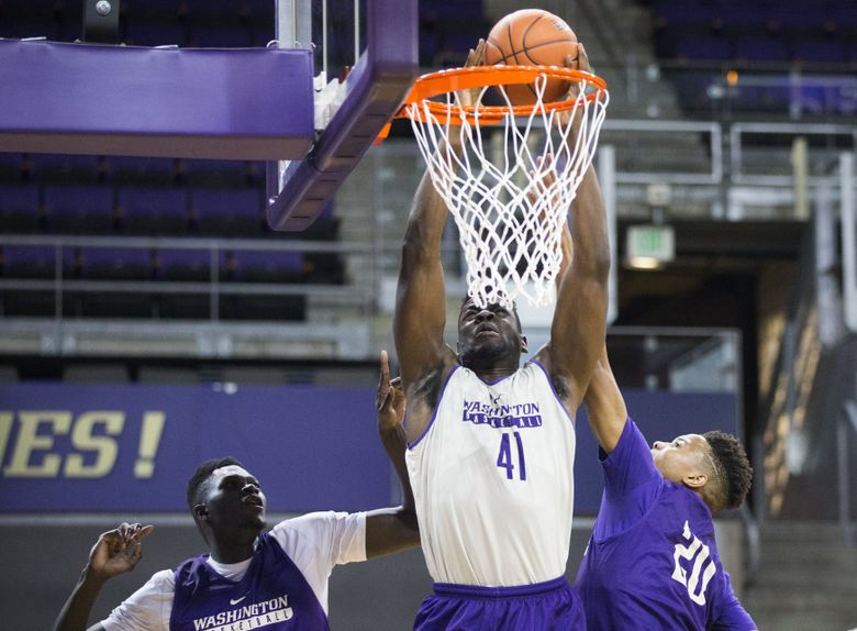 Washington forward Matthew Atewe goes up against forward Malik Dime, left and freshman guard Markelle Fultz, right, during a drill in a practice during media day at Hec Edmundson Pavilion at the University of Washington on Wednesday, Oct. 12, 2016. The Huskies start their season with an exhibition game Nov. 3 against Western Washington in Seattle.  (Lindsey Wasson/The Seattle Times)