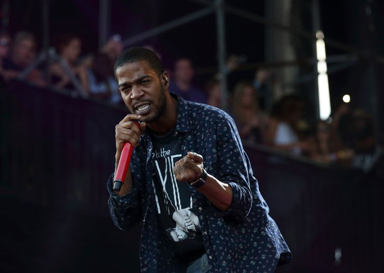 """FILE – In this Aug. 1, 2015, file photo, Kid Cudi performs at the Lollapalooza Music Festival in Grant Park in Chicago. The rapper announced on Facebook Oct. 4, 2016, that he had checked into rehab for """"depression and suicidal urges."""" (Photo by Steve C. Mitchell/Invision/AP, File)"""
