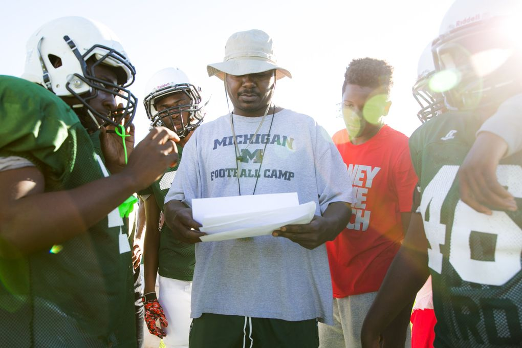 Coach Fred Jackson runs practice for the Flint Northwestern High School Wildcats. Jackson coached the Seahawks' Thomas Rawls during his time at Flint Northern High School, which closed in 2013. He now works at the two remaining public high schools in Flint, coaching at Northwestern and teaching at Southwestern.  (Bettina Hansen/The Seattle Times)