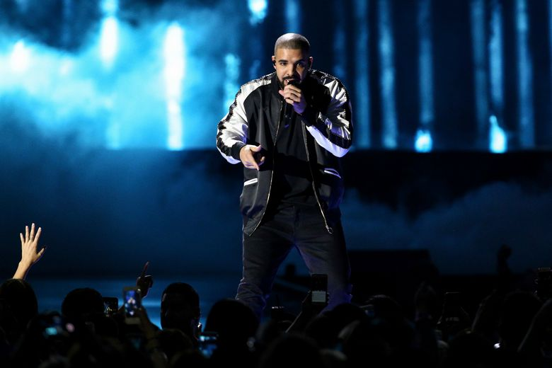 """FILE – In this Friday, Sept. 23, 2016, file photo, Drake performs at the 2016 iHeartRadio Music Festival – Day 1 at T-Mobile Arena in Las Vegas. Drake earned a record-breaking 13 American Music Awards nominations on Monday, Oct. 10, thanks to his latest album """"Views,"""" shattering Michael Jackson's mark of 11 nominations in a single year from 1984. (Photo by John Salangsang/Invision/AP, File)"""
