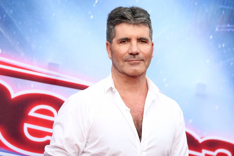 """FILE – In this March 3, 2016 file photo, Simon Cowell arrives at the """"America's Got Talent"""" Season 11 Red Carpet Kickoff in Pasadena, Calif. Cowell will serve as judge on """"America's Got Talent"""" through 2019. NBC said Tuesday, Oct. 4, that Cowell has signed on as part of the talent show's judging panel for three more seasons. (Photo by Rich Fury/Invision/AP, File)"""