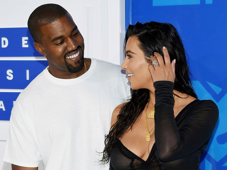 FILE – In this Aug. 28, 2016 file photo, Kanye West, left, and Kim Kardashian West arrive at the MTV Video Music Awards in New York. Armed robbers forced their way into a private Paris residence early Monday, Oct. 3, where Kim Kardashian West was staying and tied her up, police officials said. They said five assailants, who are still at large, stole a jewelry box containing valuables worth 6 million euros ($6.7 million) as well as a ring worth 4 million euros ($4.5 million.) (Photo by Evan Agostini/Invision/AP, File)