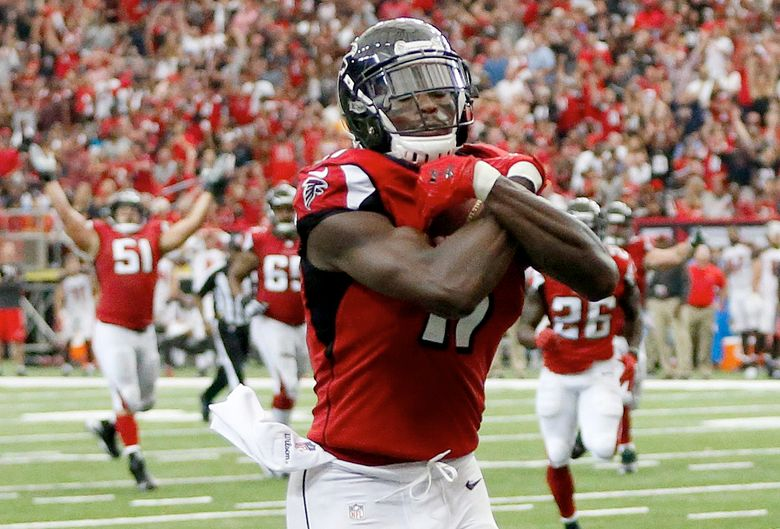 Falcons wideout Julio Jones ranks third in the NFL in receiving yards with 517 this season. (John Bazemore/AP)