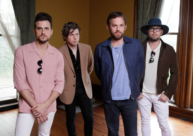 """FILE – In this Oct. 3, 2016, photo, the Kings of Leon, from left, Jared Followill, Matthew Followill, Caleb Followill, and Nathan Followill pose to promote their latest album, """"Walls,"""" in Nashville, Tenn.  For the family band Kings of Leon, one of the biggest factors in making decisions about their career is what will make their wives and children happy. The large Followill clan, which now includes three brothers, a cousin, four spouses and four children, are closer than ever as they release their seventh album, """"WALLS."""" (AP Photo/Mark Humphrey)"""