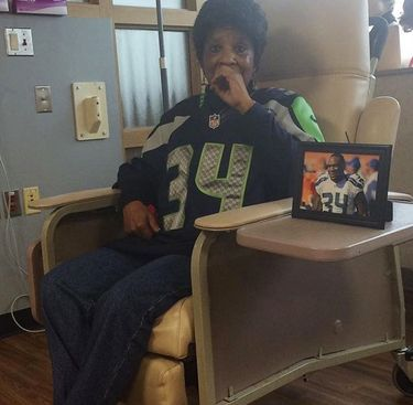 Diane Rawls, known as Granny to her family, wears her grandson Thomas Rawls' Seahawks jersey and keeps a framed photo of him by her side as she goes through chemotherapy for cancer earlier this year. (Photo courtesy Deadra Whitley)