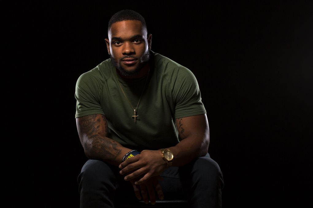 Thomas Rawls is in his second year as a running back with the Seahawks. He grew up in Flint, Mich., in the city's rough north end, but stayed on the path to success in a family that surrounded him with love. Photographed at the Seahawks' Virginia Mason Athletic Center in Renton on Oct. 5.  (Bettina Hansen/The Seattle Times)
