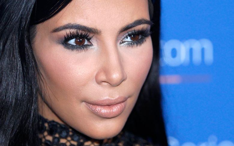 FILE – In this June 24, 2015, file photo, Kim Kardashian West poses during a photo call at the Cannes Lions 2015 in Cannes, France. Kardashian is taking some time off from sharing content on her for-pay phone app more than two weeks after she was held up at gunpoint in Paris, according to a handwritten noted posted there Monday by an assistant. (AP Photo/Lionel Cironneau, File)