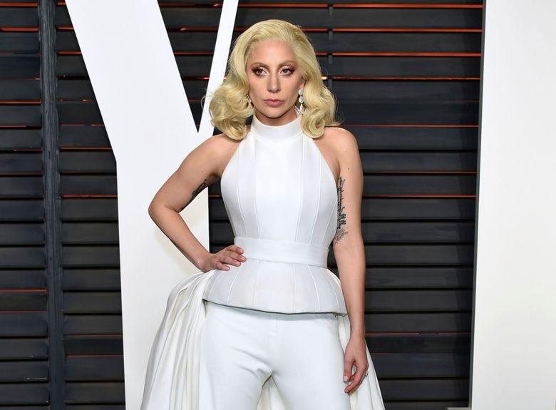 """FILE – In this Feb. 28, 2016 file photo, Lady Gaga arrives at the Vanity Fair Oscar Party in Beverly Hills, Calif. Lady Gaga is choosing the intimacy of dive bars over arenas to showcase songs from her new album, """"Joanne."""" She'll appear at a handful of bars beginning this week as a nod to the album's """"raw Americana"""" vibe and where she got her start, Gaga and tour partner Bud Light announced Sunday, Oct. 2, 2016. (Photo by Evan Agostini/Invision/AP, File)"""