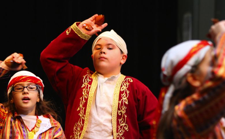 """Members of the Anadolu Youth Dancers group perform at last year's TurkFest at Seattle Center. This year's celebration is Saturday and Sunday, Oct. 15-16. For more information, see the listing under """"Fairs / Festivals.""""  (John Lok/The Seattle Times)"""