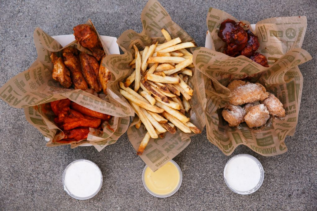 The wings at Richard Sherman's Wingstop come in classic or boneless, an array of wing packages and many different flavors. His favorites: garlic parmesan and teriyaki.  (Erika Schultz/The Seattle Times)