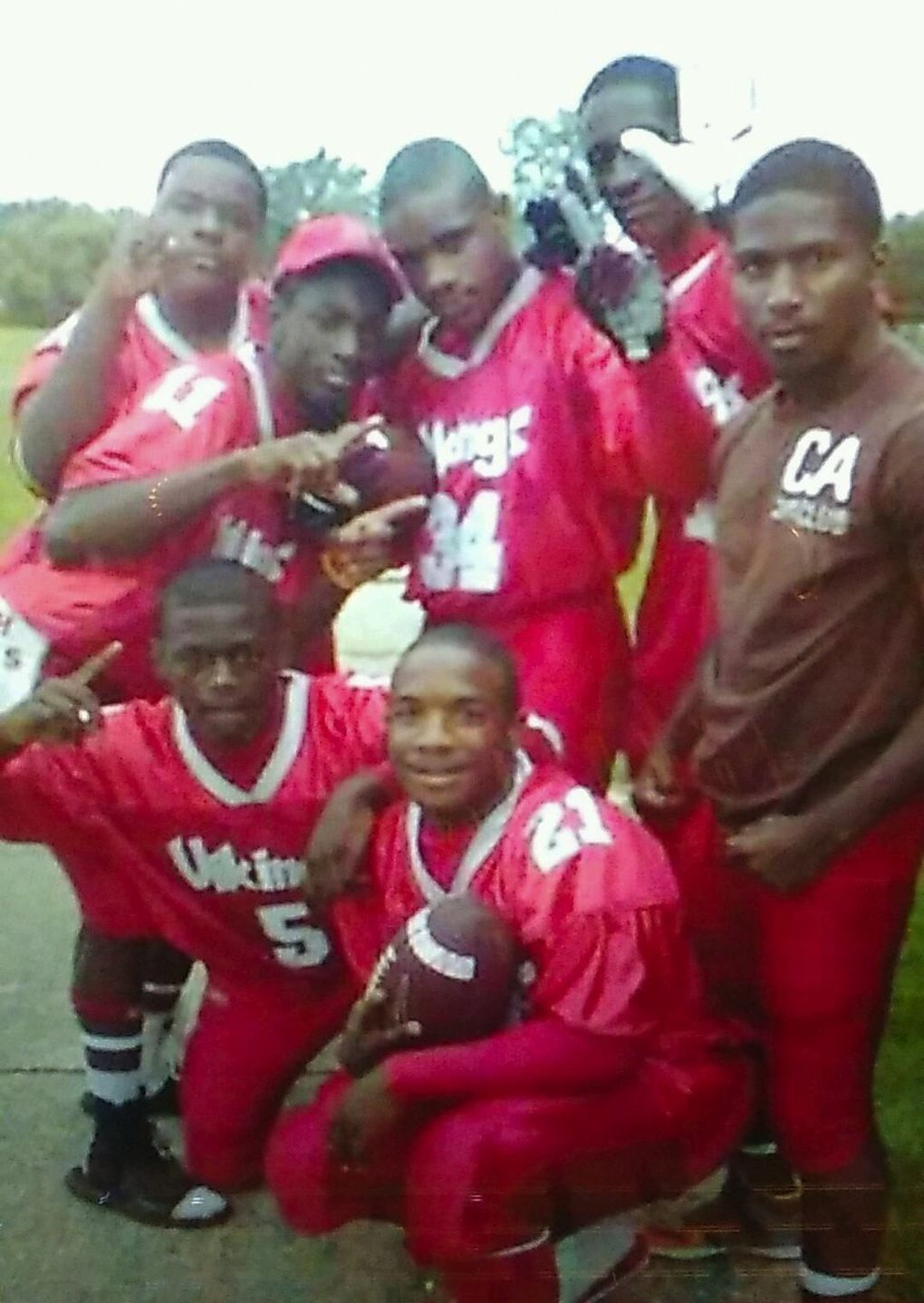 """Thomas """"Ty"""" Rawls, center (34), and his brother Thomas """"Rell"""" Rawls, bottom (21), while they played football with the Vikings of Flint Northern High School. (Photo courtesy Deadra Whitley)"""