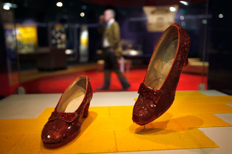 """FILE – In this April 11, 2012, file photo, Dorothy's Ruby Slippers, from the """"Wizard of Oz"""" are on display as part of a new exhibit, """"American Stories,"""" at the Smithsonian National Museum of American History in Washington. The Smithsonian launched a Kickstarter campaign to raise $300,000 to help preserve the slippers that whisked Dorothy back to Kansas at the end of the movie. Officials said they reached their goal late Sunday, Oct. 23, 2016, thanks to more than 5,300 supporters. (AP Photo/Jacquelyn Martin, File)"""