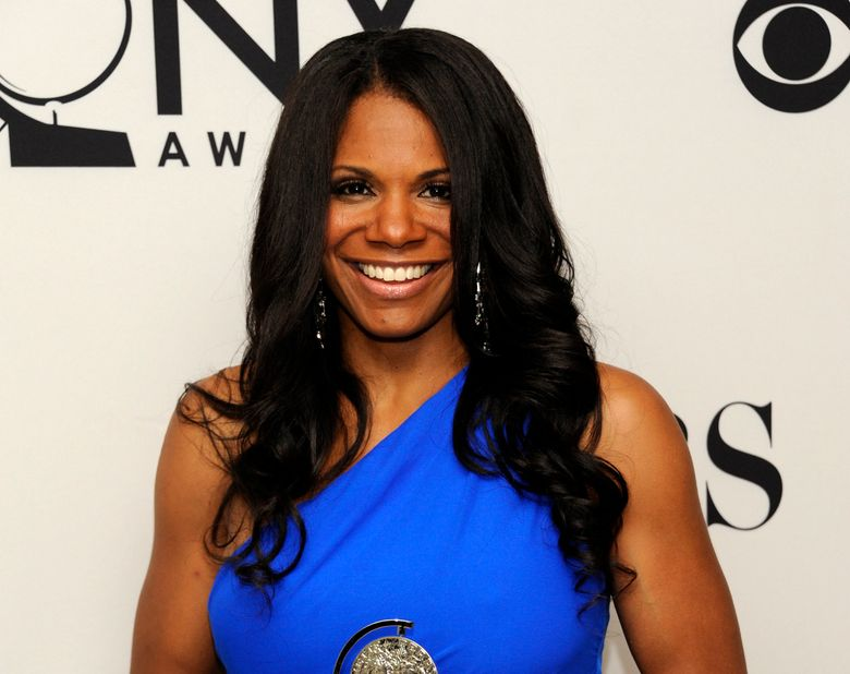 """FILE – This June 10, 2012 file photo shows Audra McDonald backstage with her award for best actress in a musical for her role in """"The Gershwins' Porgy and Bess"""" at the 66th annual Tony Awards in New York.  McDonald and Will Swenson have announced the birth of their baby girl, Sally James McDonald-Swenson, Wednesday, Oct. 19, 2016.  (Photo by Evan Agostini /Invision/AP, File)"""