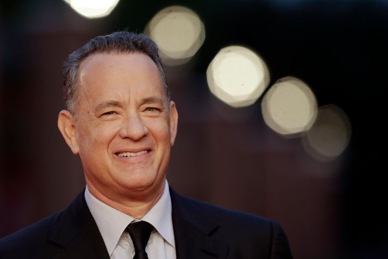 """FILE – In this Thursday, Oct. 13, 2016 file photo, actor Tom Hanks arrives to receive a lifetime achievement at the Rome Film Festival, in Rome. Within the manic action of """"Inferno,"""" the latest big-screen adaptation of a Dan Brown thriller, is a warning about the dangers of seeking simple solutions to complex problems. Star Tom Hanks says it's a theme with echoes in the current U.S. presidential race. """"Inferno"""" sets Hank's polymathic professor Robert Langdon on the trail of a deadly plague concocted by billionaire scientist Bertrand Zobrist (Ben Foster) out of a sort of warped humanitarianism: He plans to end war, poverty and famine by wiping out half the world's population. (AP Photo/Andrew Medichini, file)"""