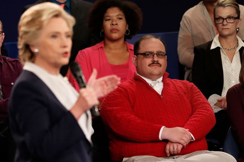 This man in the red sweater became an internet sensation after the second presidential debate. Do you know his name? (Rick T. Wilking/Pool Photo via AP)
