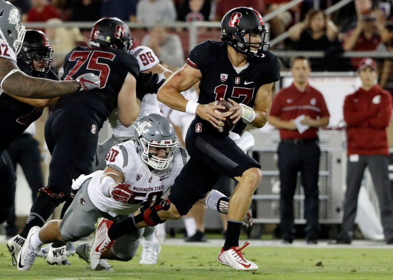 Stanford quarterback Ryan Burns (17) its tackled by Washington State defensive lineman Hercules Mata'afa (50) during the first half of an NCAA college football game Saturday, Oct. 8, 2016, in Stanford, Calif. (Marcio Jose Sanchez/AP)