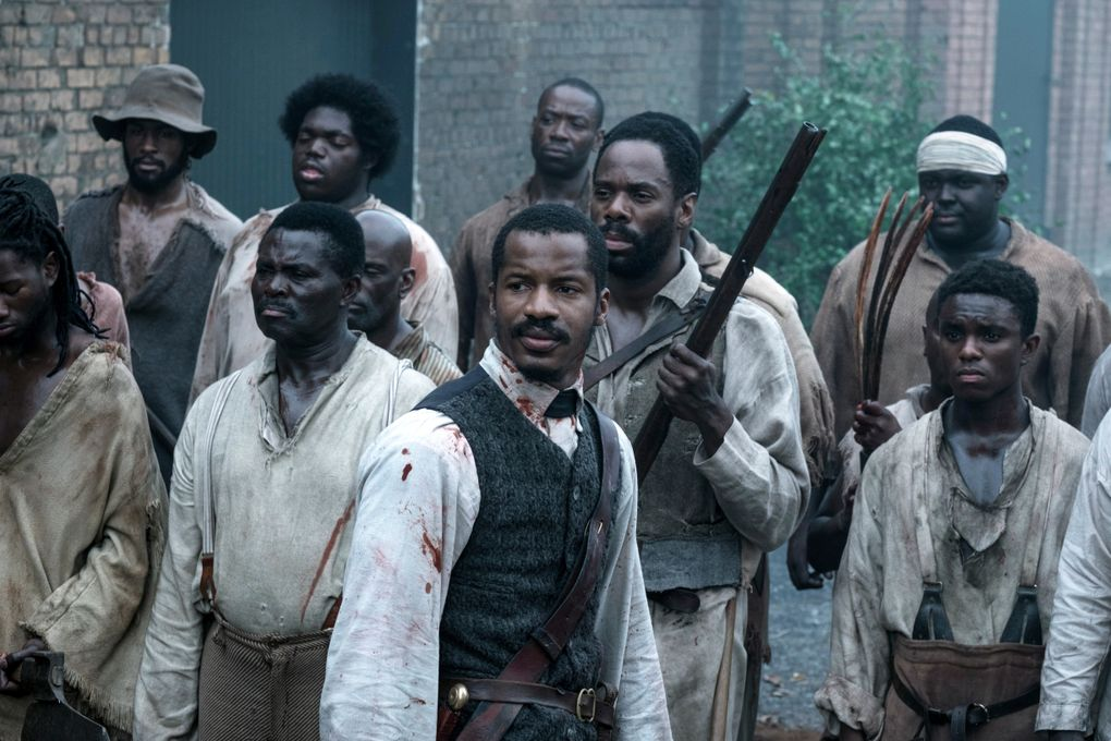 """This image released by Fox Searchlight Films shows Nate Parker as Nat Turner, center, in a scene from """"The Birth of a Nation.""""  Slavery stories were scarce prior to 2012, but their proliferation has led some to question whether viewers are becoming weary of the genre, or if Hollywood is only finally addressing the oppressive and brutal institution that lasted four centuries and remains part of the country's legacy today. (Jahi Chikwendiu/Fox Searchlight via AP)"""