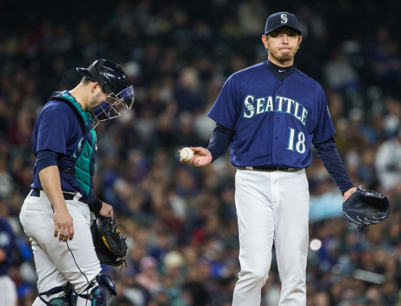 Hisashi Iwakuma had a rough start on Saturday night, giving up five runs over 32/3 innings before he was lifted for a reliever. Iwakuma gave up nine hits and struck out five. The Mariners were playing to stay alive in the American League wild-card race against the Oakland A's.  (Lindsey Wasson/The Seattle Times)