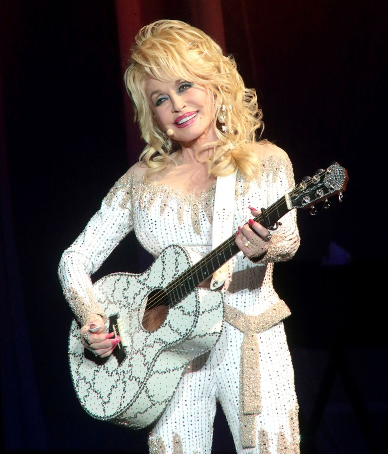 FILE – In this June 15, 2016 file photo, Dolly Parton performs in concert during her Pure & Simple Tour in Philadelphia. Parton will receive the Willie Nelson Lifetime Achievement Award at the 50th annual Country Music Association Awards in Nashville, Tenn., on Nov. 2. (Photo by Owen Sweeney/Invision/AP, File)