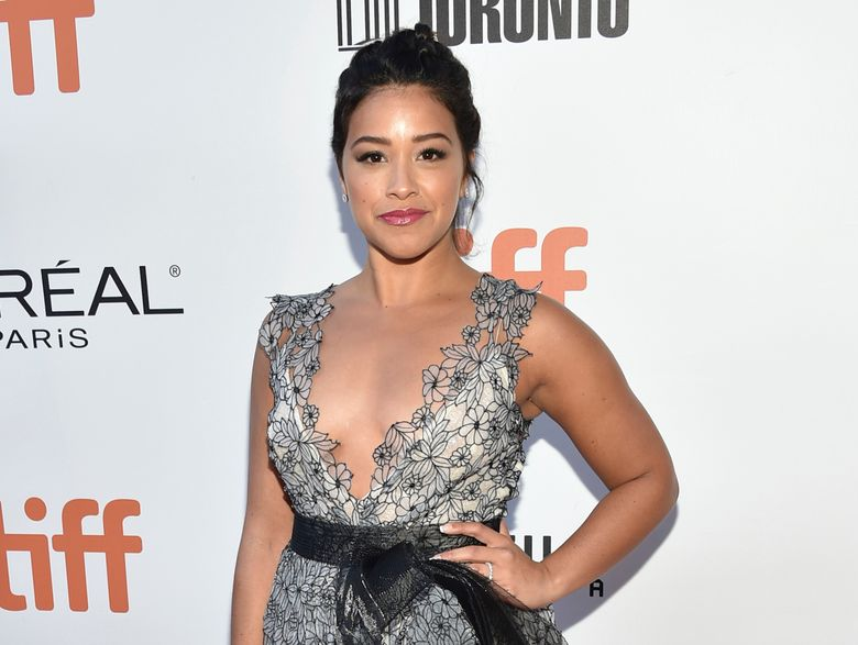 """FILE – In this Sept. 13, 2016 file photo, actress Gina Rodriguez attends the """"Deepwater Horizon"""" premiere at the Toronto International Film Festival in Toronto. Rodriguez is producing and hosting a new ceremony honoring young women making a difference in the world. Marie Claire magazine's Young Women's Honors will air Dec. 19 on the CW network. (Photo by Evan Agostini/Invision/AP, File)"""