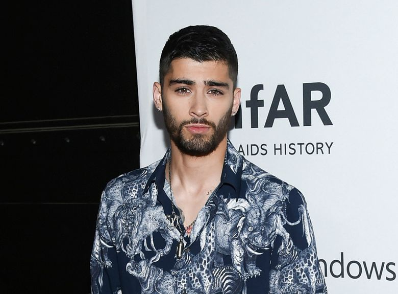 FILE – In this June 9, 2016 file photo, singer Zayn Malik attends the amfAR Inspiration Gala honoring Naomi Campbell and Kim Jones in New York. Malik will debut his Zayn X Versus capsule collection for men and women in May. He'll also appear in the Versus label's next two ad campaigns, starting in February. (Photo by Evan Agostini/Invision/AP, File)