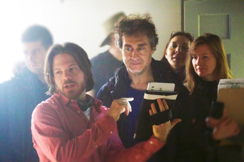 """In this image released by Conde Nast Entertainment (CNE) Jerome Sable, foreground from left, Doug Liman and Julina Tatlock appear on the set of """"Invisible,"""" a scripted sci-fi series in 360-degree virtual reality.  Its first season of five six-minute episodes is now available on Samsung VR as well as the Jaunt VR app and on desktop browsers. The series will also be distributed on The Scene, CNE's digital video platform. (Conde Nast Entertainment via AP)"""