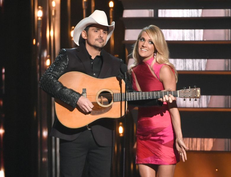 FILE – In this Nov. 4, 2015 file photo, hosts Brad Paisley, left, and Carrie Underwood speak at the 49th annual CMA Awards in Nashville, Tenn. Paisley and Underwood, along with Dierks Bentley, Eric Church, Maren Morris and Keith Urban will perform at the 50th annual Country Music Association Awards show on Nov. 2. (Photo by Chris Pizzello/Invision/AP, File)