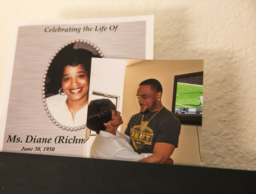 """A photo of Thomas Rawls and """"Granny"""" Diane Rawls, along with the program from her memorial service, hangs at mom Deadra Whitley's house. Granny Rawls passed away in March of 2016, and she was very close with Thomas, or as they know him, Ty.  (Bettina Hansen/The Seattle Times)"""