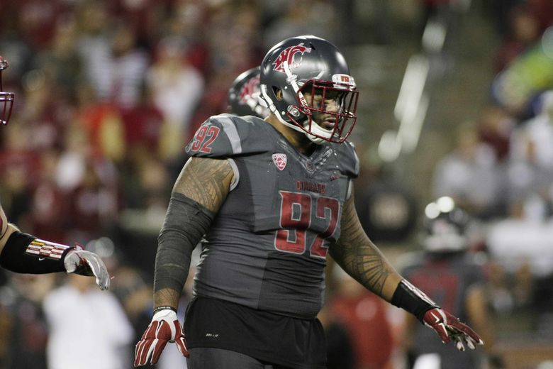 Washington State nose tackle Robert Barber (92) stands on the field during the second half of an NCAA college football game against Oregon in Pullman, Wash., Saturday, Oct. 1, 2016. (AP Photo/Young Kwak) OTK