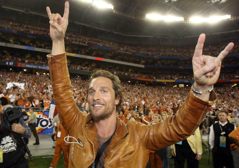 FILE – In this Jan. 5, 2009, file photo, actor Matthew McConaughey celebrates after Texas defeated Ohio State 24-21 in the Fiesta Bowl NCAA college football game in Glendale, Ariz. McConaughey took a turn behind a wheel of a golf cart on the University of Texas campus Monday, Nov. 28, 2016, to raise awareness about a program that ensures students don't have to walk home alone. (AP Photo/Ross D. Franklin, File)