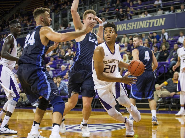 Markelle Fultz tries to run baseline, but is fouled late in the game against Western.   (Dean Rutz / The Seattle Times)
