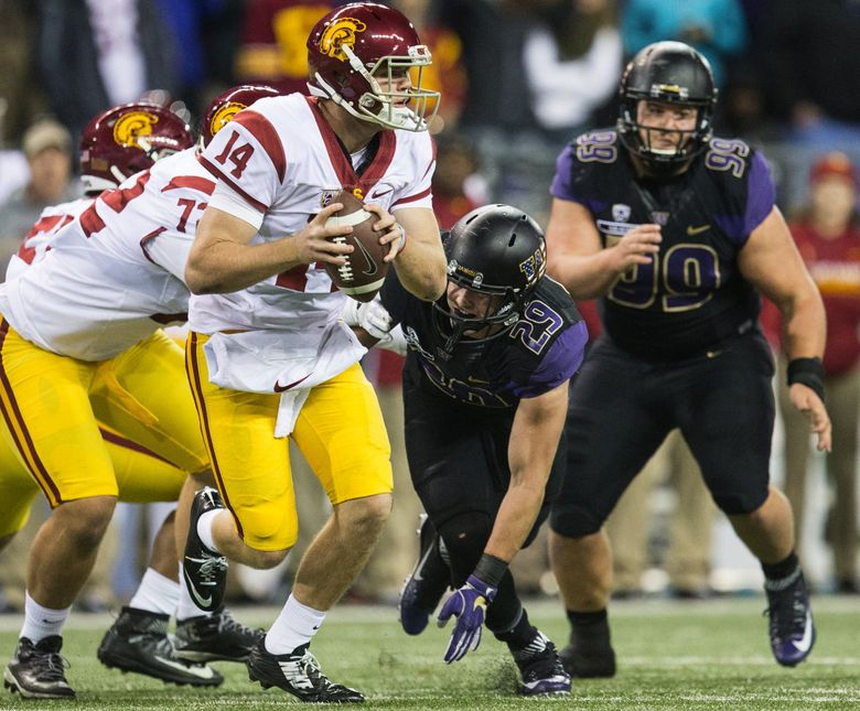 USC Trojans quarterback Sam Darnold escapes pressure from Washington Huskies linebacker Connor O'Brien in the third quarter during the game at Husky Stadium.  (Lindsey Wasson / The Seattle Times)