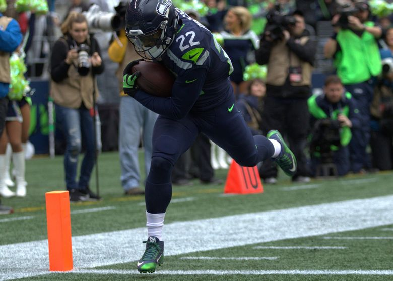 Seahawks running back C. J. Prosise runs for a 72-yard touchdown in the first quarter. (Dean Rutz / The Seattle Times)
